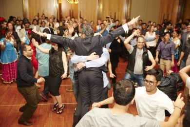 Rise to the top with a happy team who dances to Bollywood
