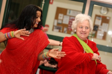 Seniors bollywood dance in red